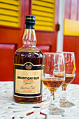 A bottle and two glasses of Mount Gay Rum, Mount Gay Rum Factory, near Bridgetown, Barbados, Caribbean