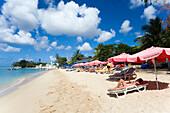 People relaxing at beach, Speightstown, Barbados, Caribbean