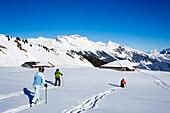 Back country skiers near an alpine hut, Maennlichen, Grindelwald, Bernese Oberland, Canton of Bern, Switzerland