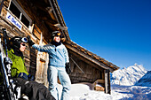 Back country skiers resting at alpine hut, Maennlichen, Grindelwald, Bernese Oberland, Canton of Bern, Switzerland