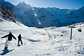 Snowboarders on slope near ski lift, First, Grindelwald, Bernese Oberland, Canton of Bern, Switzerland