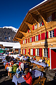 Guests resting on terrace of the mountain restaurant Bort, First, Grindelwald, Bernese Oberland, Canton of Bern, Switzerland