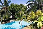 Guests bathing in the swimming pool, Sarova Whitesands Beach Resort and Spa, Shanzu Beach, Coast, Kenya