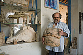 Artist with sculpture in his workshop, Larnaka, South Cyprus, Cyprus