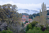 Mountain landscape with cherry blossoms and church, Pano Platres, Troodos mountains, South Cyprus, Cyprus