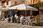 Outdoor cafe in the main village square, Omodos, Troodos mountains, South Cyprus, Cyprus