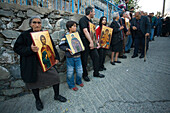 People holding icons at a procession, Orthodox icon procession, Agros, Troodos mountains, South Cyprus, Cyprus