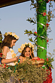 Two young girls at the Anthesteria Flower Festival, parade, Germasogeia, Limassol, South Cyprus, Cyprus