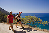 A young couple hiking along the coast, view of the sea, Mediterranean, Akamas Nature Park, Cyprus