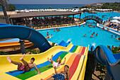 Three young men on a water slide, water park, Acapulco Beach Club and Resort Hotel, 10km east of Kyrenia, Girne, Keryneia, Cyprus