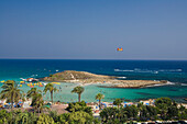 View of Nissi beach with palm trees, Agia Napa, South Cyprus, Cyprus
