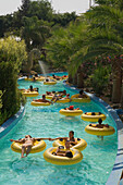 People floating in rubber tyres, WaterWorld, waterpark, Agia Napa, South Cyprus, Cyprus