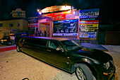 A stretch limousine parked in front of the Abyss disco, nightlife, Agia Napa, South Cyprus, Cyprus
