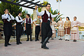 A group of men and women dancing, Cypriot Folk dance, Commandaria Wine Festival, Limnati, Cyprus