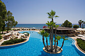 Hotel Pool with palm trees, Le Meridien Limassol Spa and Resort, Limassol, Cyprus