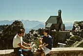 Couple having a rest near Wendelstein church, Wendelstein, Upper Bavaria, Bavaria, Bavaria, Germany