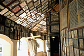 Man carrying a cross through Chapel of the Miraculous Image, Altotting, Bavaria, Germany