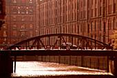 Speicherstadt with bridge, warehouse district, storage area of the city, Hamburg, Germany
