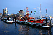 Fireboat at pier in the evening, Hamburg, Germany