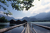 Jetty and boathouses at Kochelsee lake, Bavaria, Germany
