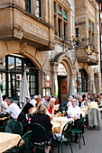 People sitting at tables outside a restaurant, Zum Braunen Mutz, Barfuesserplatz, Basel, Switzerland