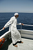 North african man on a ship. Harbour. Tanger. Morocco.