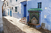 Fountain. Typical street. Chefchaouen. Morocco