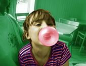 Girl blowing big bubble