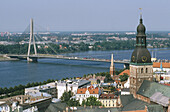 Vansu bridge over Daugava river, Cathedral tower at left. Riga. Latvia