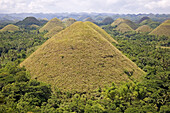 The Chocolate Hills are numerous mounds of earth whose grasses turn from green to brown during summer. These hills of mysterious origin are a most famous natural attraction, Bohol island, Philippines
