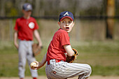 Little league baseball game, with full safety gear, all boys aged from 5 to 9, in Atlanta. Georgia. USA.