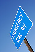 Aid, Blue, Blue sky, Color, Colour, Daytime, Emergencies, Emergency, Emergency Dial 911, Exterior, Help, Information, Low angle view, Outdoor, Outdoors, Outside, Road, Road sign, Road Signs, Roads, Safety, Security, Skies, Sky, Telephone number, Telephon