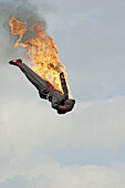People on local carnival rides for fun during summer vacations at Florida State Fair US fire jumper from 90 feet