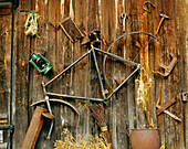 Metal junk on a wooden barn wall
