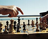 Action, Adult, Adults, Beach, Beaches, Board, Board game, Board games, Boards, Chess, Chessboard, Chessboards, Chessman, Chessmen, Close up, Close-up, Closeup, Color, Colour, Contemporary, Daytime, Decision making, Decision-making, Decisions, Detail, Det