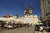 Outdoor cafe in Prague s Old Town Square with the Church of our Lady before Tyn in the background. Czech Republic. 2006.