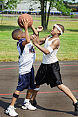 6  year old black youths fight for control of a basketball