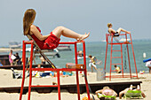 Male and female life guard protect swimmers at a public beach in Port Huron Michigan