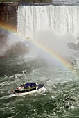 Maid of the Mist tourist boat and rainbow at Niagra Falls Ontario Canada and the United States