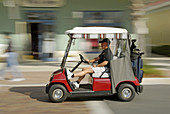 Golf carts are the main transportation at The Villages is a retirement community near Orlando and Ocala Florida developed for active senior citzens to provide a full range of activities for a couple in retirement