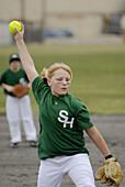 Young girls play softball