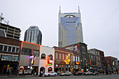 Neon Signs along Streets and Bell South Building in Nashville. Tennessee. USA.
