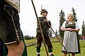 Older man and woman in traditional dress, Lederhosen, Dirndl dress, on an alpine pasture, Gosau, Upper Austria, Austria