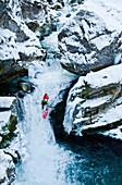 Man kayaking in Strumboding Water Fall in winter, Upper Austria, Austria