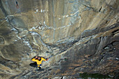 Free climber scaling rock face, Malta Valley, Hohe Tauern National Park, Carinthia, Austria