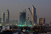 Construction Equipment and cranes in the evening sky, Construction development, Dubai, United Arab Emirates