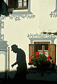 Shadow of an old man at house wall, Bergun/Bravuogn, Grisons, Switzerland