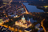 Aerial shot of New Town Hall and lake Maschsee at night, Hanover, Lower Saxony, Germany
