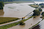 aerial view of truck driving through floodwaters, farmland, Leine River in the Hanover region, Lower Saxony, northern Germany
