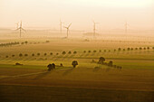 aerial of wind turbines in evening light, Lower Saxony, northern Germany